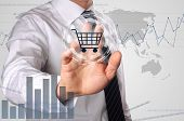 picture of cart  - business man pressing shopping cart icon concept for growing online shopping - JPG