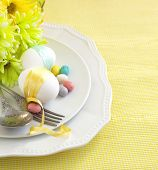 image of easter candy  - Easter Table Setting With Flowers And Eggs - JPG