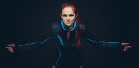 stock photo of fetish clothes  - Art portrait of futuristic woman on black background - JPG