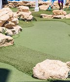 foto of miniature golf  - Fake plastic grass on a miniature golf course on a luxury cruise ship - JPG