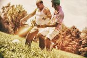 picture of older men  - Older men and younger men plays soccer together - JPG