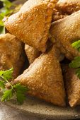 stock photo of samosa  - Homemade Fried Indian Samosas with Mint Chutney Sauce - JPG