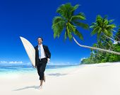 stock photo of rune  - Businessman with surfboard on the beach - JPG