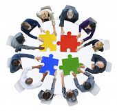 stock photo of jigsaw  - Business People with Jigsaw Puzzle and Teamwork Concept - JPG