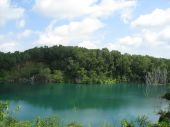 stock photo of groundwater  - An abandoned quarry filled with groundwater to form a pond - JPG