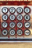 stock photo of dial pad  - Street phone both dialing pad with obsolete keys - JPG