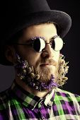 picture of bowler hat  - Strange young man with a beard of flowers wearing elegant bowler hat and glasses - JPG