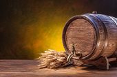 foto of fermentation  - Old oak barrel on a wooden table - JPG