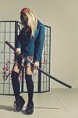 foto of schoolgirl  - Schoolgirl with katana preparing to fight over japanese screen  - JPG
