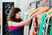 image of boutique  - Young woman having fun while fashion shopping in boutique or store - JPG