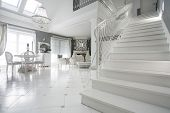 stock photo of enormous  - Picture of luxury sophisitcated interior with marble stairs - JPG