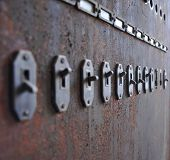 picture of fuse-box  - Old switches from a fuse box in an abandoned building - JPG