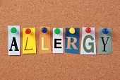 image of hay fever  - The word Allergy in cut out magazine letters pinned to a corkboard - JPG