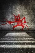 picture of pedestrian crossing  - Drawing devil on wall above pedestrian crossing - JPG