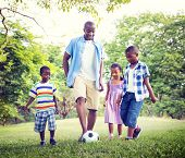 stock photo of family bonding  - Family Bonding Recreation Sports Football Concept - JPG
