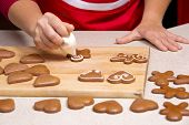 stock photo of ginger bread  - woman making ginger bread cookies in the kitchen - JPG