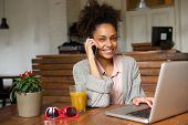image of people talking phone  - Close up portrait of a happy young woman talking on phone at home  - JPG