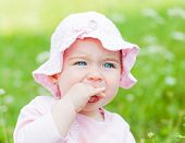stock photo of teething baby  - Close up photo of an adorable baby girl - JPG