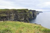 stock photo of cliffs moher  - Cliffs of Moher and Atlantic Ocean - JPG