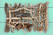 stock photo of driftwood  - Driftwood abstract design on wooden green background - JPG