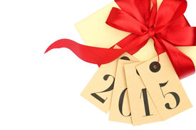 stock photo of bowing  - Gift box with red bow and tags with new year 2015 isolated on white - JPG