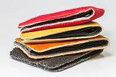 stock photo of cash cow  - Handmade leather pocket bag on white background - JPG