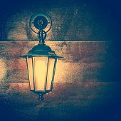 image of luminaria  - The Lamp lantern on a wooden background - JPG