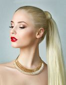 foto of ponytail  - Beauty portrait of gorgeous blonde woman with ponytail - JPG