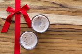 stock photo of peppermint  - holiday shooters chocolate and peppermint on a wooden background with a red ribbon - JPG