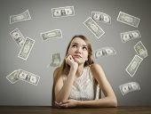 picture of lottery winners  - Girl in white and falling dollar banknotes - JPG