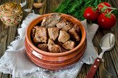 pic of stew  - Beef stew with Bay leaf and pepper on wooden table - JPG