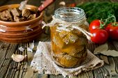 pic of hermetic  - Canned meat in a glass jar on a wooden table - JPG
