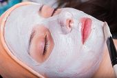 foto of black woman spa  - Young woman at spa procedures applying mask - JPG