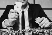 stock photo of poker hand  - Poker player in the casino - JPG