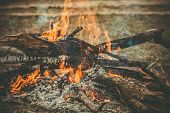 stock photo of flames  - Fire Flame wooden camp burning Outdoor travel vacations concept moody background - JPG