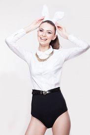 image of bunny costume  - portrait of playful model in bunny costume - JPG