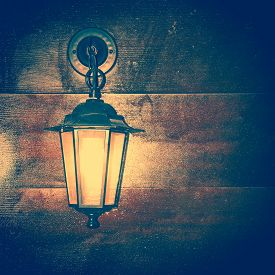 picture of luminaria  - The Lamp lantern on a wooden background - JPG