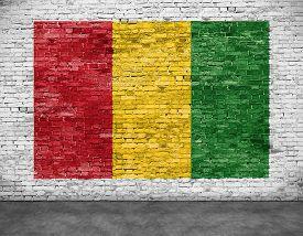 stock photo of reggae  - Reggae flag painted on white brick wall - JPG