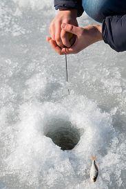 stock photo of ice fishing  - Winter fishing - JPG