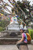 pic of buddhist  - A man near the Buddhist stupa  - JPG