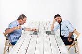 stock photo of exaltation  - The two colleagues working together at office on light gray background - JPG