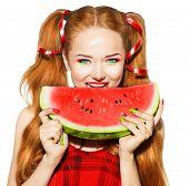 foto of watermelon slices  - Beauty teenage model girl eating watermelon - JPG