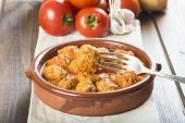 stock photo of meatball  - Meatballs with tomato sauce on the table of the kitchen - JPG