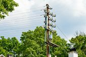 stock photo of pole  - Electric wires on isolators against the sky - JPG