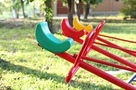 stock photo of seesaw  - Seesaw board at public playground park on sunny day  - JPG