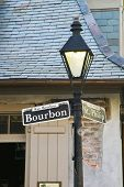 stock photo of blacksmith shop  - Bourbon Street sign with the haunted Lafitte - JPG