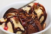 stock photo of ice cream sundaes  - Chocolate and Vanilla ice cream in a bowl with chocolate and strawberry syrup and nuts - JPG