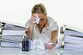 woman in office with burnout poster