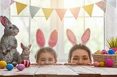 Happy easter! Mother and daughter begin to hunt for Easter eggs. Happy family preparing for Easter.  poster