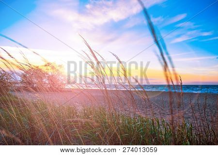 poster of Beautiful Blazing Scenery Of The Sunset Over The Sea And The Orange Sky Above Him With Amazing Golde
